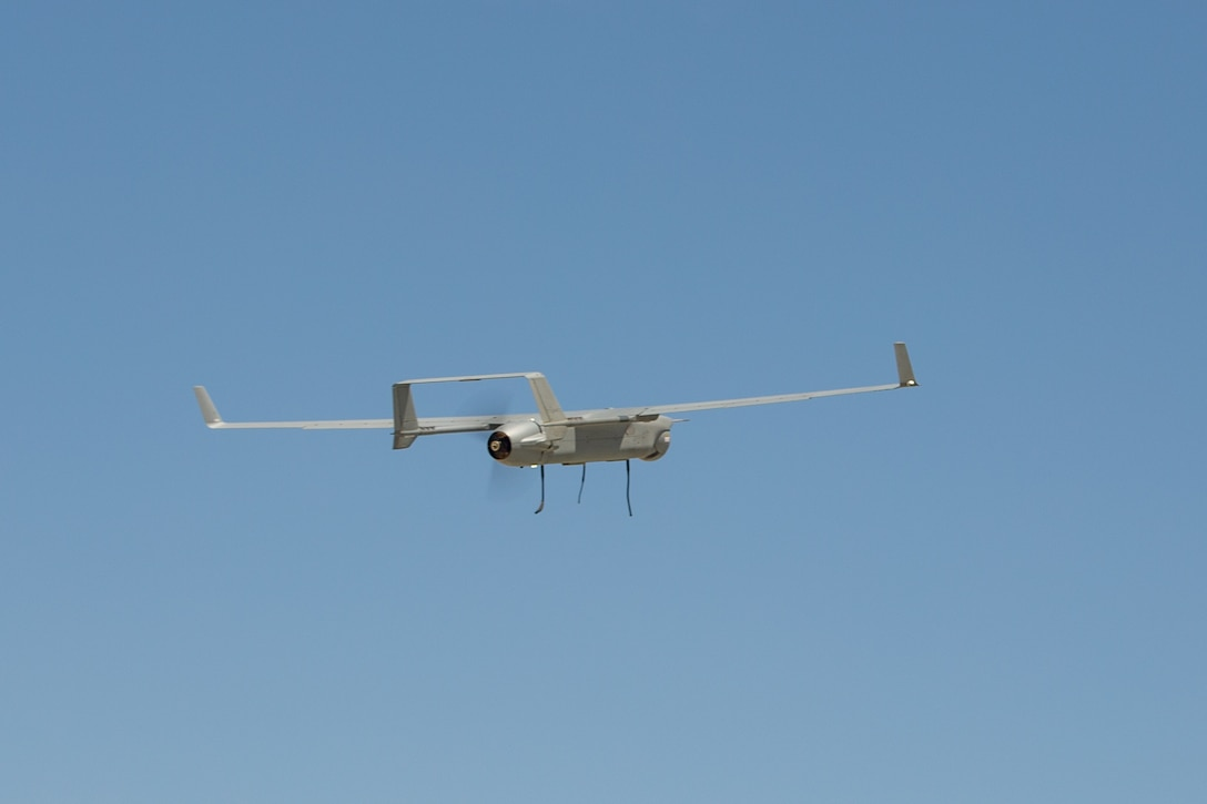 An RQ-21 Blackjack assigned to Marine Unmanned Aerial Vehicle Squadron (VMU) 2 flies over Marine Corps Air-Ground Combat Center Twentynine Palms, California, May 5, 2021. VMU-2 and other squadrons assigned to Marine Aircraft Group (MAG) 29 are training to integrate with and support various Marine ground units as part of Service Level Training Exercise (SLTE) 3-21. SLTE is a series of exercises designed to prepare Marines for operations around the globe by increasing their ability to operate and conduct offensive and defensive combat operations. MAG-29 is a subordinate unit of 2nd Marine Aircraft Wing, the aviation combat element of II Marine Expeditionary Force. (U.S. Marine Corps photo by Lance Cpl. Elias E. Pimentel III)