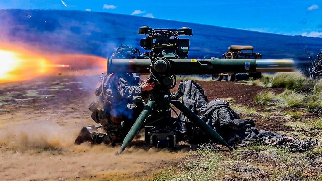 A U.S. Marine with 1st Battalion, 3rd Marines, fires a TOW missile during exercise Bougainville II at Pohakuloa Training Area, Hawaii, April 18, 2021. Bougainville II is the second phase of pre-deployment training conducted by the battalion designed to increase combat readiness through complex and realistic live-fire training.