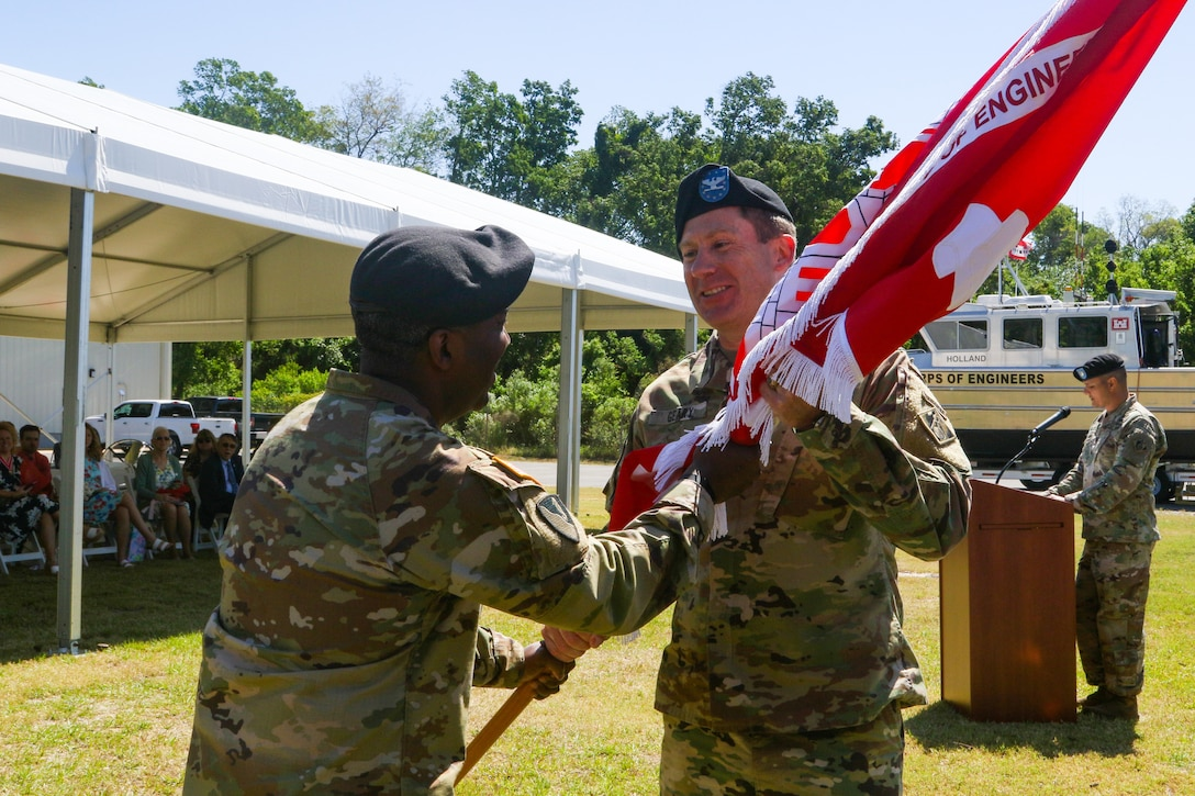 Savannah District Commander Col. Joseph Geary accepts the unit colors from U.S. Army Corps of Engineers South Atlantic Division Commander Col. (P) Jason Kelly during a change of command ceremony at the Engineer Depot on Hutchinson Island in Savannah, Ga., May 7.