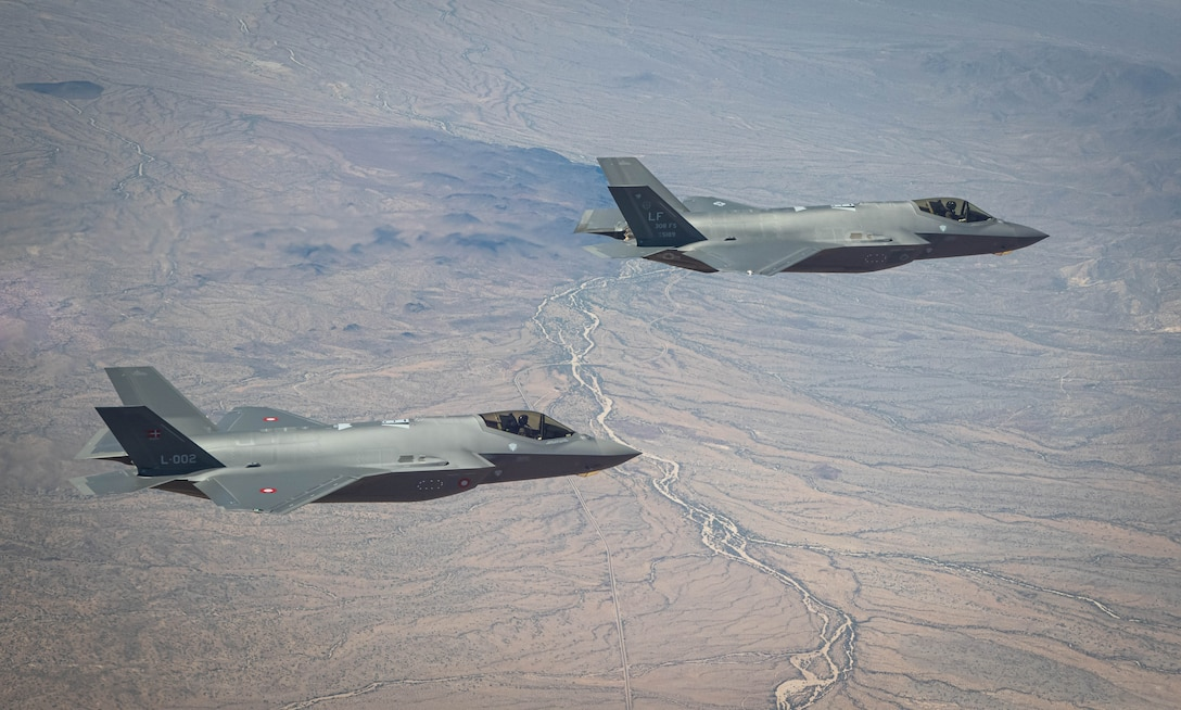 U.S. Air Force and Royal Danish Air Force F-35A Lightning II fighter jets assigned to the 308th Fighter Squadron, Luke Air Force Base, Arizona, fly in formation May 5, 2021, over Bagdad, Arizona.