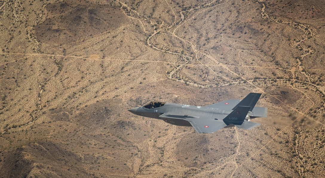 A Royal Danish Air Force F-35A Lightning II fighter jet assigned to the 308th Fighter Squadron,  Luke Air Force Base, Arizona, soars over Bagdad, Arizona, May 5, 2021.