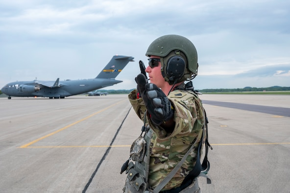 Staff Sgt. Nathan Adams, 1st Battalion, 623rd Field Artillery Regiment, Kentucky Army National Guard field artillery crew member guides an M142 High Mobility Artillery Rocket System off of a C-130J Super Hercules assigned to the 19th Airlift Wing at Volk Field Air National Guard Base, Wisconsin, May 20, 2021. The HIMARS is a multiple rocket launcher developed in the late 1990s for the U.S. Army, mounted on a standard Army M1140 truck frame and is vital to the joint force integration. (U.S. Air Force photo by Senior Airman Aaron Irvin)
