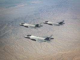 U.S. Air Force, Royal Danish Air Force and Royal Netherlands Air Force F-35A Lightning II fighter jets assigned to the 308th Fighter Squadron, Luke Air Force Base, Arizona, fly in formation May 5, 2021, over Bagdad, Arizona.