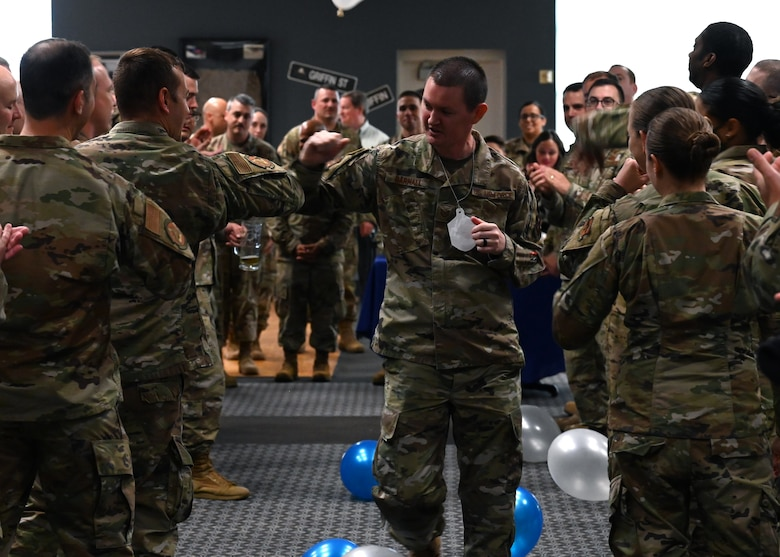 U.S. Air Force Master Sgt. select Bradley Darnall, 313th Training Squadron instructor, runs through a crowd of supporters during the master sergeant release party at the Event Center on Goodfellow Air Force Base, Texas, May 20, 2021. Coworkers and family members congratulated selectees before they received their certificates. (U.S. Air Force photo by Airman 1st Class Michael Bowman)