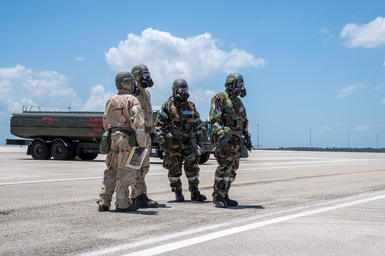 U.S. Air Force Airmen from the 6th Logistics Readiness Squadron perform a post-attack reconnaissance (PAR) sweep at MacDill Air Force Base, Florida, during a large-scale readiness exercise (LRE), May 19, 2021. PAR sweeps are a vital part of phase two of the LRE in order to ensure sustainment. (U.S. Air Force photo by Airman 1st Class Hiram Martinez)