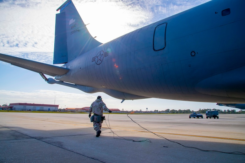 A maintainer with the 6th Aircraft Maintenance Squadron (AMXS) prepares a KC-135 Stratotanker aircraft for take-off at MacDill Air Force Base, Florida, May 20, 2021. The 6th AMXS ensured that the KC-135 Stratotankers were ready to provide air refueling at a moment's notice, anywhere in the world. (U.S. Air Force photo by Airman 1st Class Hiram Martinez)