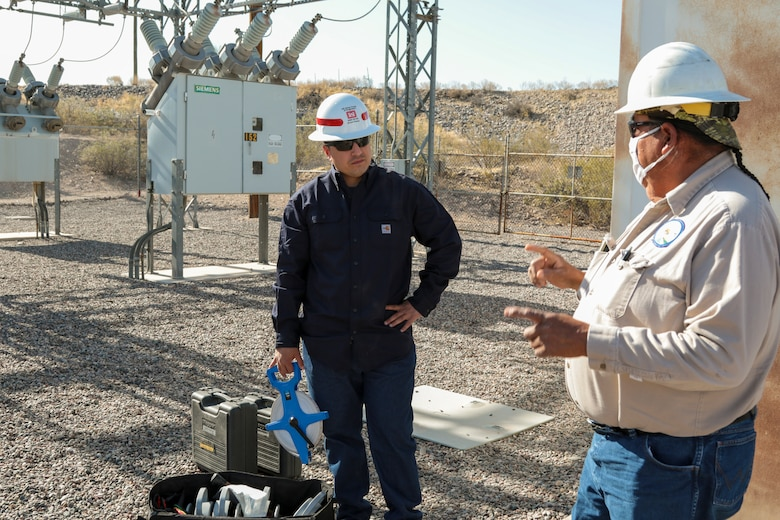 George Gorman (right), a supervisory electrician with the San Carlos Irrigation Project, discusses site safety May 19 with Sgt. Eduardo Delacruz, Alpha Company, 249th Engineer Battalion, U.S. Army Corps of Engineers. Delacruz and Staff Sgt. Jacob Wratchford are testing a San Carlos Irrigation Project's substation grounding May 19 by testing soil conductivity. The 249th is charged with the rapid deployment of U. S. Army generators to support worldwide requirements.