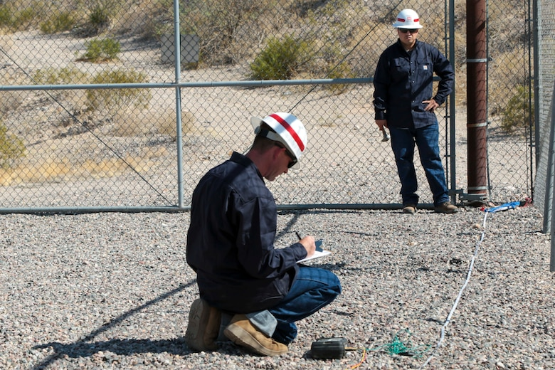 Staff Sgt. Jacob Wratchford (center) and Sgt. Eduardo Delacruz, Alpha Company, 249th Engineer Battalion, U.S. Army Corps of Engineers, are testing a San Carlos Irrigation Project's substation grounding May 19 by testing soil conductivity. The 249th is charged with the rapid deployment of U. S. Army generators to support worldwide requirements.