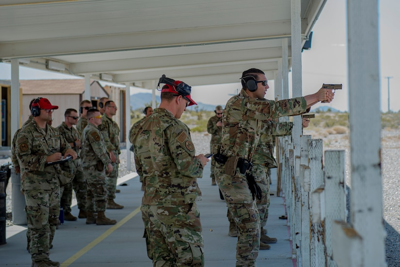 432nd Security Forces Squadron members take aim at a target for the security forces shooting competition