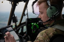 U.S. Air Force Capt. Zachary Robinson, 39th Airlift Squadron pilot, checks a map while flying over Michigan during Mobility Guardian, May 20, 2021. Mobility Guardian includes AMC's first large-scale training on Agile Combat Employment, setting the standard for the role mobility aircraft plays in projecting the joint force.