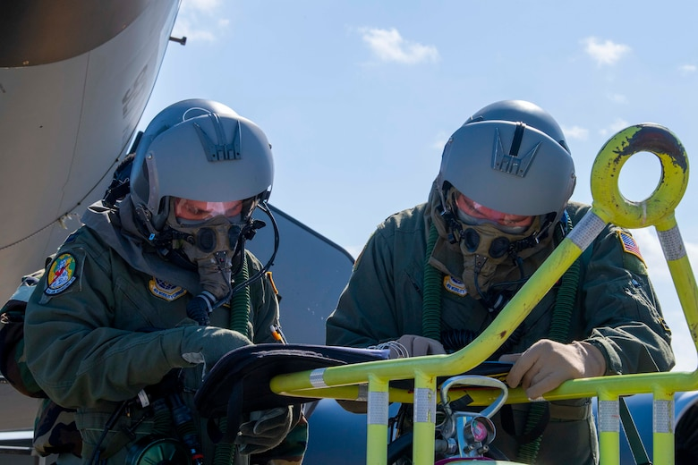 KC-135 Stratotanker aircraft pilots with the 91st Air Refueling Squadron (ARS) perform pre-flight checks during a large-scale readiness exercise (LRE), at MacDill Air Force Base, Florida, May 20, 2021. The 91st ARS also took part in phase two of the LRE to practice providing air refueling in a simulated contested environment.  (U.S. Air Force photo by Airman 1st Class Hiram Martinez)