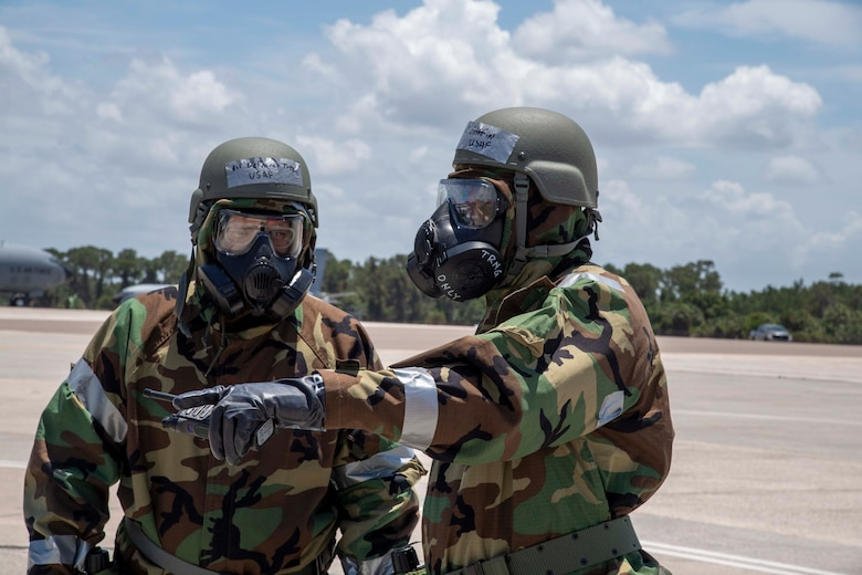 U.S. Air Force Airmen from the 6th Logistics Readiness Squadron perform a post-attack reconnaissance (PAR) sweep at MacDill Air Force Base, Florida, during a large-scale readiness exercise, May 19, 2021. PAR sweeps assess any damages caused by enemy opposition to help commanders make decisions on protective postures and recovery actions. (U.S. Air Force photo by Airman 1st Class Hiram Martinez)