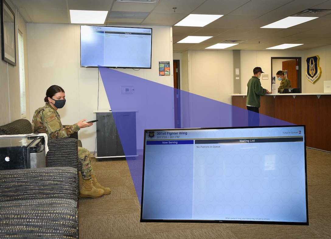 Senior Airman Lexi Smith 301st Fighter Wing Force Support Squadron customer support technician waits for her scheduled appointment using the wing's new Queue Kiosk system at U.S. Naval Air Station Joint Reserve Base Fort Worth, Texas. This system can be accessed via QR code scan, internet link and even the wing's app on Air Force Connect. Sign-up, check-in, with a few button clicks. (U.S. Air Force graphic by Jeremy Roman)