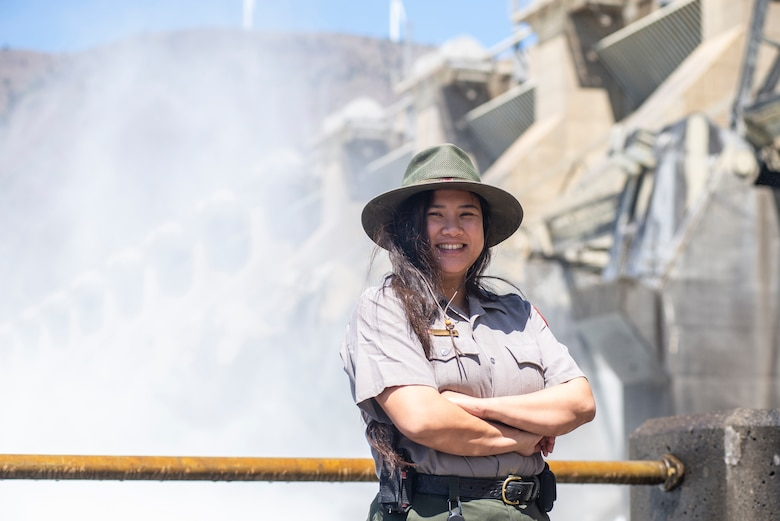 A ranger stand in front of a dam spillway.