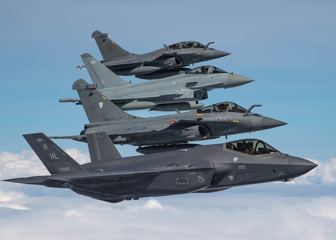 U.S. Air Force, French and Royal Air Force fighter aircraft participate in formation flight