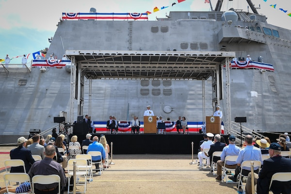 Cmdr. Christopher Wolff, commanding officer of USS Mobile (LCS 26), delivers remarks during the commissioning ceremony of Mobile. Mobile is the Navy's 13th Independence-variant littoral combat ship. (U.S. Navy photo by Mass Communication Specialist 2nd Class Alex Millar/Released)
