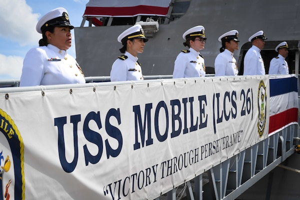 he crew of USS Mobile (LCS 26), man the ship during the commissioning ceremony of Mobile. Mobile is the Navy's 13th Independence-variant littoral combat ship.