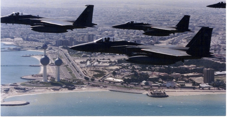 In this historic photo, a four-ship of F-15C Eagles, deployed from Eglin Air Force Base, fly over the Persian Gulf in the 1990s. The then-named 33rd Tactical Fighter Wing, flew combat air patrol and high value airbourne asset protection missions as part of Operations Desert Storm and Southern Watch. (Courtesy photo)