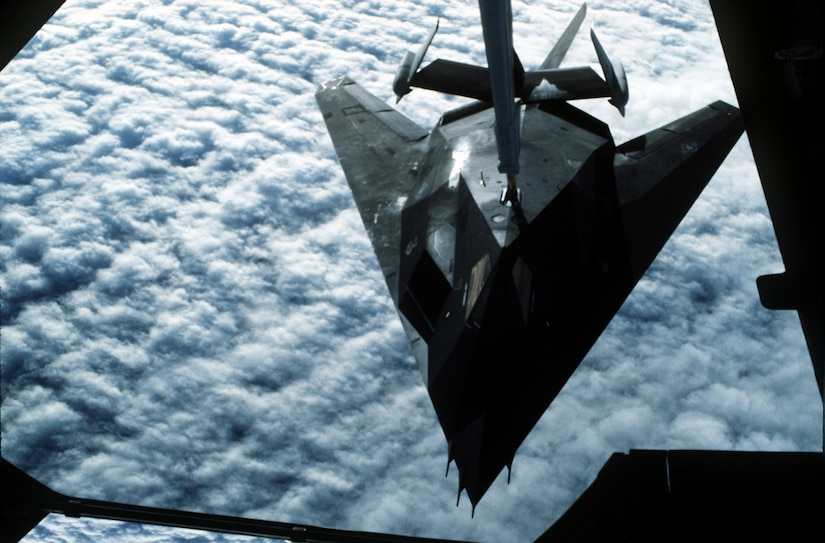A 37th Tactical Fighter Wing F-117A stealth fighter aircraft refuels from a 22nd Air Refueling Wing KC-10 Extender aircraft during Operation Desert Shield. The F-117A is en route to Saudi Arabia.