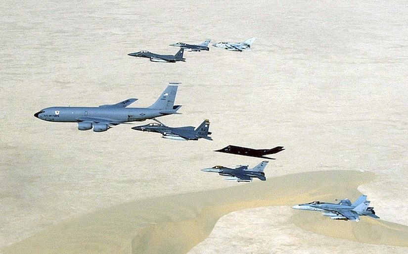 Aircraft of the 379th Air Expeditionary Wing and coalition counterparts fly over the desert in Southwest Asia on April 14, 2003. Aircraft include the KC-135 Stratotanker, F-15E Strike Eagle, F-117 Nighthawk, F-16 Fighting Falcon, British GR-4 Tornado and Australian F/A-18 Hornet. (U.S. Air Force photo/Master Sgt. Ron Przysucha)