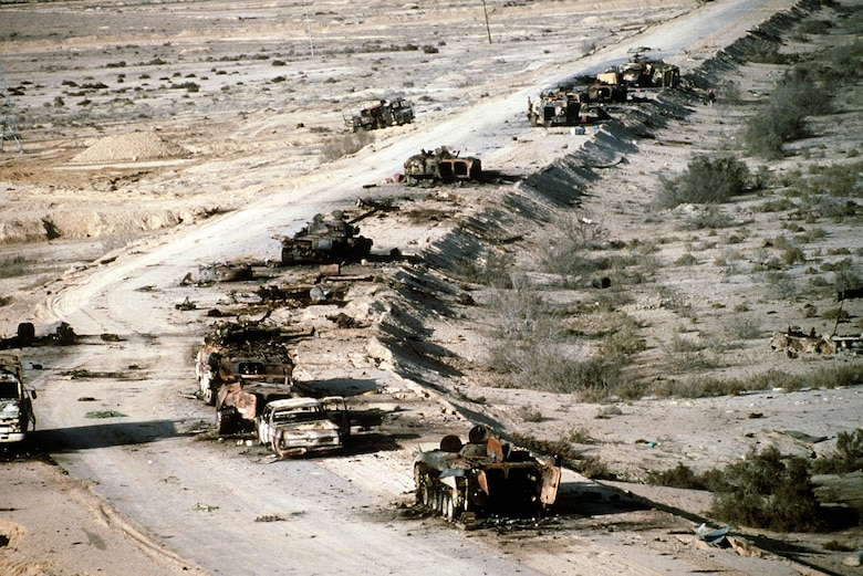 A view of Iraqi armored personnel carriers, tanks and trucks destroyed in a Coalition attack along a road in the Euphrates River Valley during Operation Desert Storm.