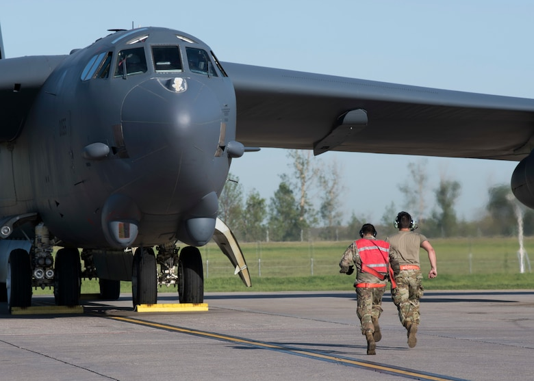 From left, Airmen 1st Classes Rubio Steven and Ian Arriaza, 5th Aircraft Maintenance Squadron crew chiefs, prepare a B-52H Stratofortress for takeoff at Minot Air Force Base, North Dakota, June 2, 2020. The B-52s are conducting a long-range, long duration strategic Bomber Task Force mission throughout Europe and the Arctic region. (U.S. Air Force photo by Senior Airman Alyssa Day)