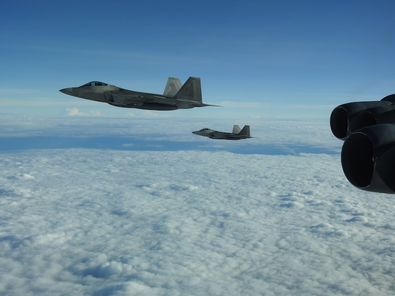 F-22 Raptors escort a B-52 Stratofortress during a North American Aerospace Defense Command (NORAD) mission, June 14, 2020. NORAD routinely conducts intercept training in support of its mission to protect the sovereign airspaces of the United States and Canada. (Courtesy Photo)