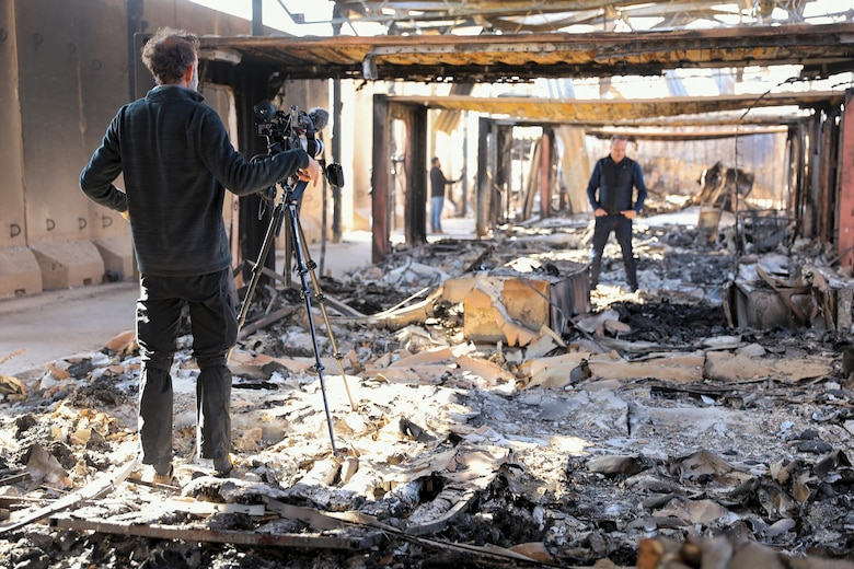 News agencies conduct field reporting in destroyed living quarters after the missile attacks at Al Asad Air Base, Iraq, Jan. 13, 2020. (U.S. Army photoA U.S. Airman searches for salvageable items in the debris caused by recent missile attacks at Al Asad Air Base, Iraq, Jan. 12, 2020.