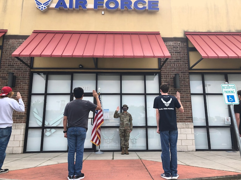 Lt Col Nora DeLosRios, 341st Recruiting Squadron commander, administers the oath of enlistment to future Airmen just before they were bused to training from a recruiting office in Live Oak, Texas, on April 7, 2020. Due to the threat of COVID-19, Air Force Recruiting Service adjusted its procedures for transporting Airmen to Basic Military training through Agile Shipping methods. Maintaining the flexibility of the accession pipeline is crucial to ensuring the Air Force can continue to deliver mission ready professionals to combatant commanders around the world.