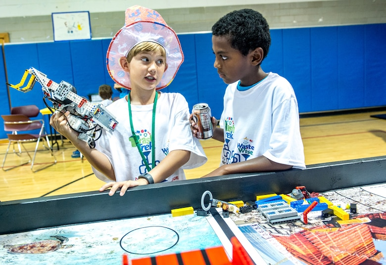 Samuel Snowden, 9, left, who is homeschooled and claims to have been born with a Lego in his hand, talks strategy with teammate Samson Scheie, 12, also homeschooled, before running their robot in the First Lego League competition at DoD's Starbase building near the Air Force Research Laboratory at Wright Patterson Air Force Base in Dayton, Ohio, Jul 22, 2016. The Air Force STEM outreach offices work with the First Lego League, which teaches young students how to build and program robots made of Legos, to not only support STEM education, but also to make young technical minds aware of opportunities to pursue science in the U.S. Air Force. (U.S. Air Force photo by J.M. Eddins Jr.)