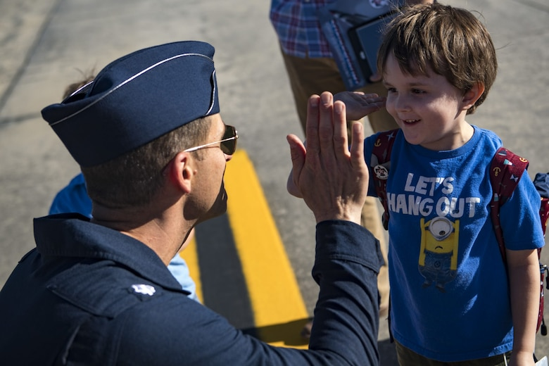 A Thunderbird pilot interacts with a young fan, during Thunder Over South Georgia, Oct. 27, 2017. The Thunderbirds are the Air Force's premier aerial demonstration team, performing at air shows and special events worldwide.