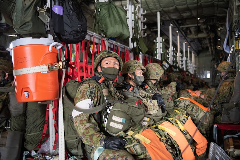 Japan Ground Self-Defense soldiers in the loading bay of a C-130J Super Hercules.