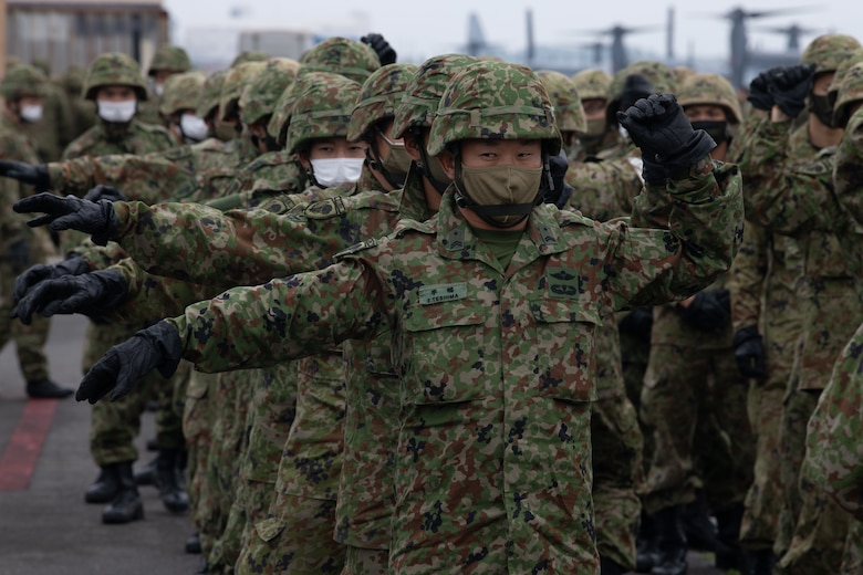 Japan Ground Self-Defense soldiers exercise in formation.
