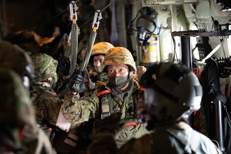 Japan Ground Self-Defense Force soldiers use a static-line in a C-130J Super Hercules aircraft.