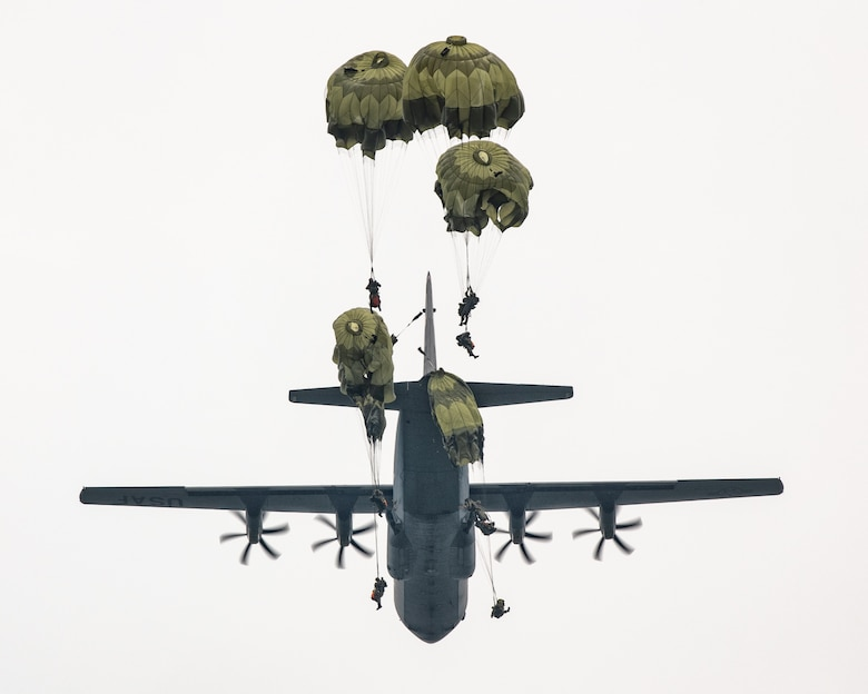 Japan Ground Self-Defense Force soldiers parachute from a C-130J Super Hercules
