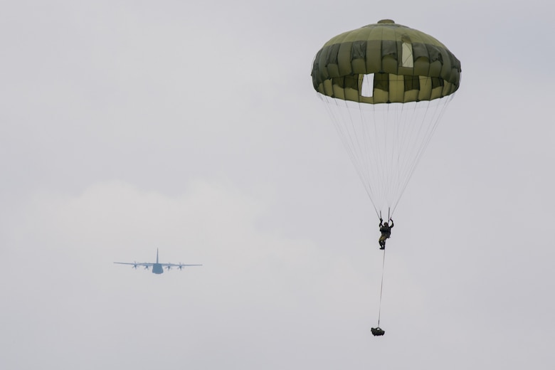 Japan Ground Self-Defense soldier parachutes from aircraft