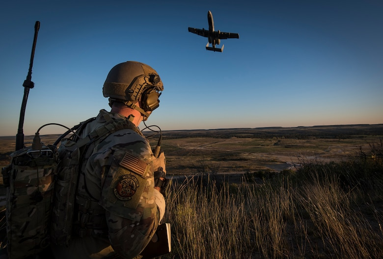 A Tactical Control Party Airmen and qualified Joint Terminal Aircraft Controller assigned to the 9th Air Support Operations Squadron at Fort Hood, Texas, directs an A-10 Thunderbolt II aircraft during a close-air-support exercise at Fort Hood, Texas Oct. 30, 2020. The 330th Recruiting Squadron used this exercise, along with the 2020 Lightning Challenge to publicize the capabilities of Special Warfare Airmen. (U.S. Air Force photo by Master Sgt. JT May III)