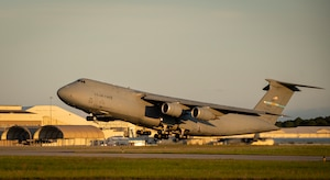A C-5M Super Galaxy lifts off for a mission at Eglin Air Force Base, Fla., May 13. The Dover AFB aircraft and crew visited the base for a series of nighttime defensive countermeasures tests on Eglin's ranges.