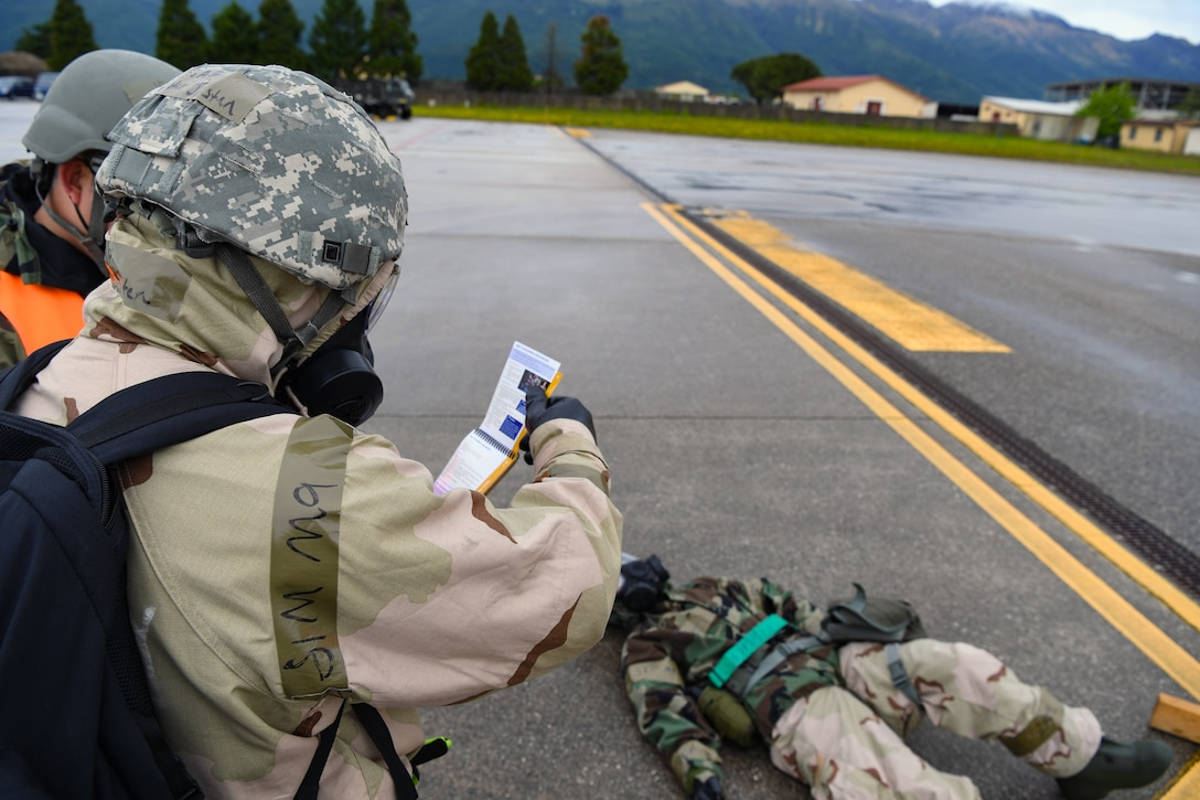 U.S. Airmen with the 724th Air Mobility Squadron participate in a Nodal Lightning exercise at Aviano Air Base, Italy, May 19, 2021. Nodal Lightning is a simulated air and chemical attack followed by other scenarios that test the teams Chemical, Biological, Radiological and Nuclear response. (U.S. Air Force photo by Airman 1st Class Thomas S. Keisler IV)