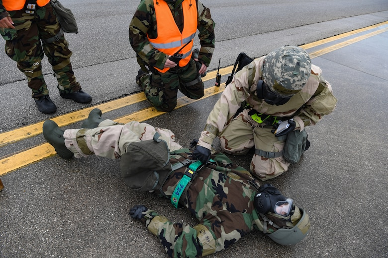 U.S. Airmen with the 724th Air Mobility Squadron provide first aid and buddy care during Nodal Lightning exercise at Aviano Air Base, Italy, May 19, 2021. Nodal Lightning is conducted by the 521st Air Mobility Operations Wing, which tests readiness in air mobility units around U.S. Air Forces in Europe. (U.S. Air Force photo by Airman 1st Class Thomas S. Keisler IV)