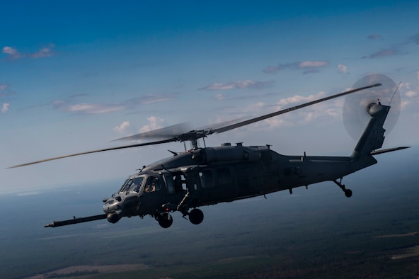 An HH-60G Pave Hawk from the 41st Rescue Squadron flies through the air during a rapid-rescue exercise, Nov. 3, 2016, near Tyndall Air Force Base, Fla.
