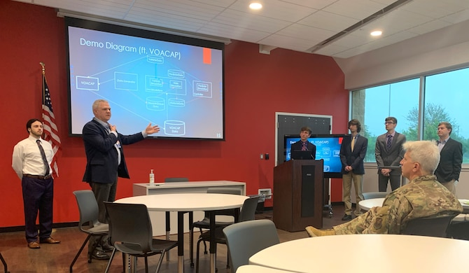 Donald Copsey, AFGSC Fellows Project Champion, briefs command and Louisiana Tech University officials May 19, 2021 on capstone project results at the Louisiana Tech Academic Success Center in Bossier City, Louisiana. Managed by Louisiana Tech University, the Fellows Program is an AFGSC initiative to collaborate with academia, invest in developing innovative solutions to command challenges and foster future generations of students who aim to work for the Department of Defense. (Courtesy Photo by Sean Green)