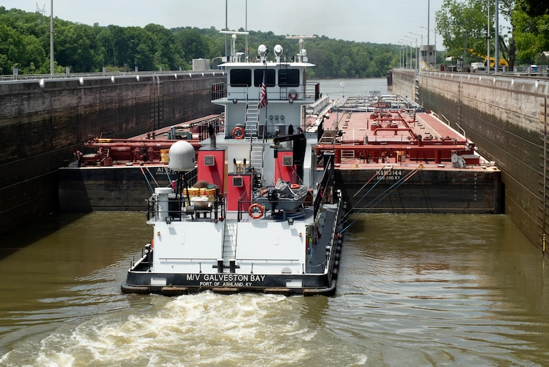 The Motor Vessel Galveston Bay out of Ashland, Kentucky, moves empty Marathon Petroleum Company fuel barges May 21, 2021 through Cheatham Lock in Ashland City, Tennessee, headed downstream back to refineries in Texas. The U.S. Army Corps of Engineers Nashville District worked with the fuel industry and Regional Rivers Repair Fleet, which is performing maintenance at the lock, to schedule openings to accommodate the movement of fuel barges on the Cumberland River. (USACE Photo by Lee Roberts)