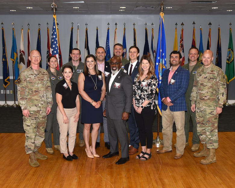 Honorary commanders pose with their unit commanders.