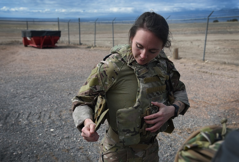 woman putting on gear