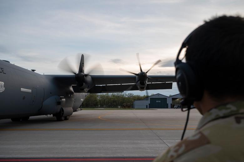 An Airman performs an engine check