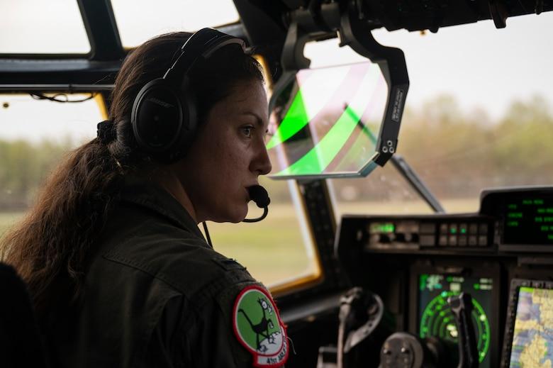 Airmen preform a pre-flight check of a C-130J