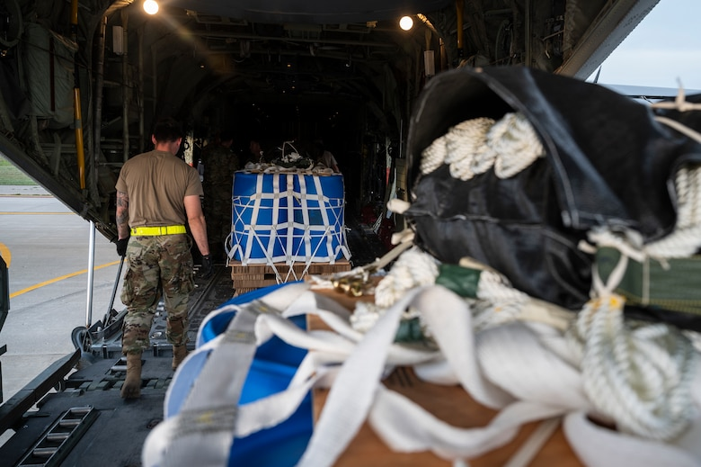 Airmen load a container delivery system