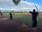 Army Recovery Care Program Soldiers take up ax throwing and archery