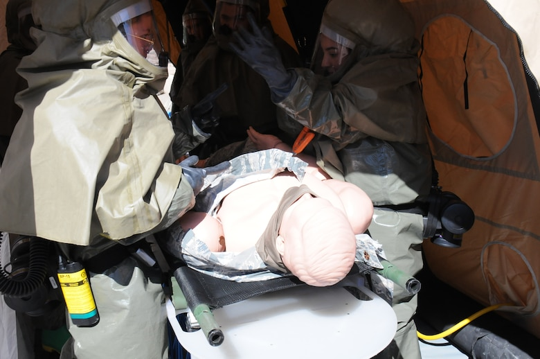 Military medical teams decontaminates a simulated patient